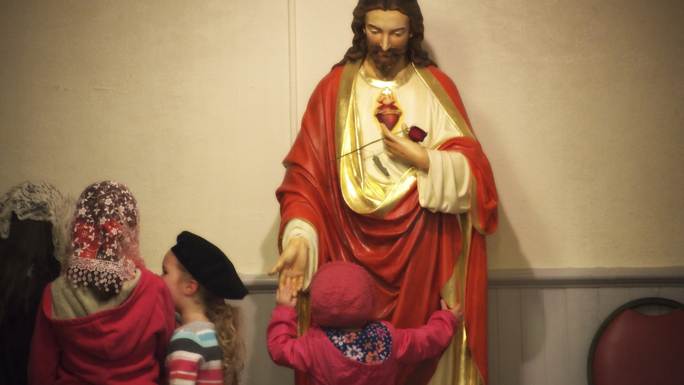 St. Patrick's Jesus Statue - Girl wants to hold His hand